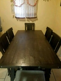 rectangular brown wooden table with six chairs din Los Angeles, 91402