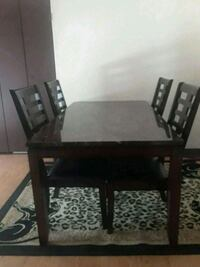 rectangular brown wooden table with four chairs dining set Snellville, 30039