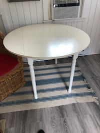 round white wooden table with two chairs Boston, 02125