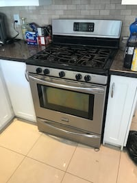 Frigidaire gas stove.  Excellent condition.  3 yr old. Paid $2000. Must go. 1st good offer takes It