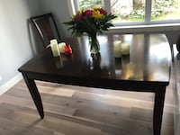 Solid dining room table from the Brick Calgary, T3C 3C9