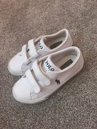 Pair of white polo strap shoes