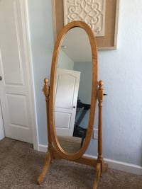 oval cheval mirror with brown wooden frame South Mills, 27976