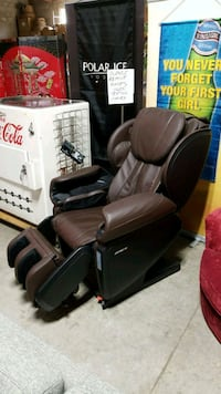 black leather padded rolling armchair Mississauga, L4X 1R1
