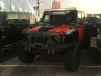 red and black Jeep Wrangler 1191 mi