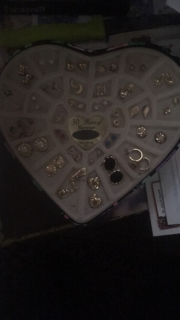 30 earrings in a heart shape tin container