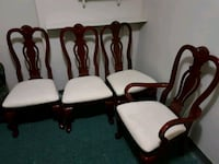 four brown wooden framed white padded chairs Mississauga