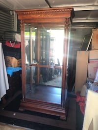 Howard Miller Large curio cabinet with glass shelves