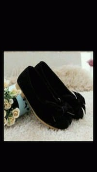 pair of women's black suede loafers