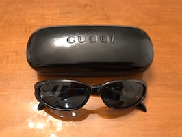 Authentic GUCCI shiny black sunglasses with case