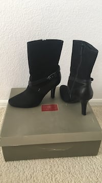 pair of women's black leather side-zip buckled high-heeled wide-calf boots with box