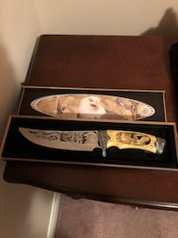 beige handled knife with box
