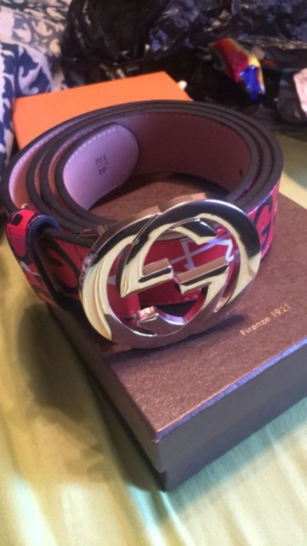 red and black Gucci belt