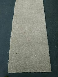 Beige area rugs. Several sizes. One burgundy rug.