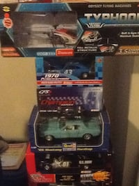 4 assorted Collectable car's toys in boxes.