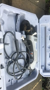 Black and gray dremel corded power tool with gray case