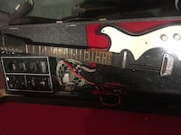 black and red electric guitar Staunton, 24401