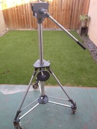 Professional television camera tripod with dolly