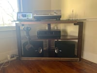 black wooden TV stand with flat screen television Tampa, 33604