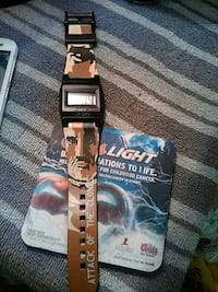 black digital watch with brown strap Springfield