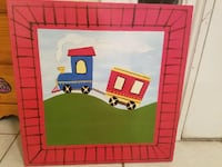 blue and pink train painting with pink frame