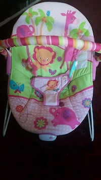 baby's pink and green Fisher-Price bouncer Chestermere, T1X 1S5