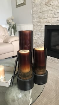 Three brown and black pillar candles Surrey, V3S 7Y3