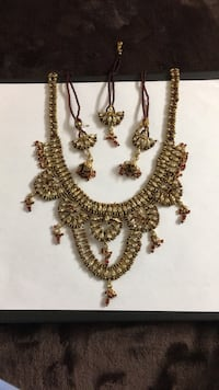 gold-colored necklace with earrings Morganville, 07751