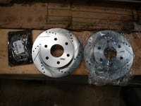 Rotors cross drilled and slotted and ceramic pads  542 mi