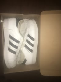 White-and-black adidas superstar shoes with box