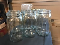15 mason jars, nine with lids. Six large jars have no lids Leesburg