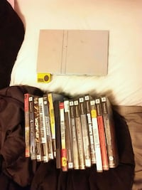 Silver Sony PS2 games & console with game cases Sevierville, 37876