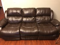 Brown leather 3-seat couch reclines and cup holders