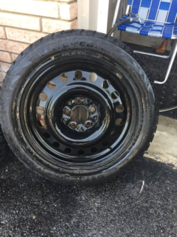 4 - 17 inch Snow Tires on steel rims 2- blizzak and 2- glacier grip 4
