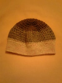 brown, gray, and white knit cap