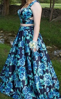 Women's blue floral prom dress size 10. Altered for short people. Has pockets. Will go down on price a little.  Shelbyville, 37160