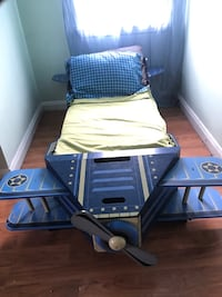 blue and white airplane bed frame with mattress