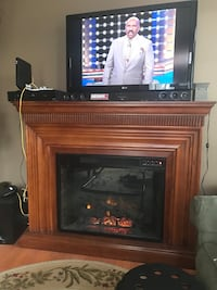 brown wooden framed electric fireplace Woodbridge, 22191