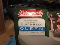 Brand new Coleman Queen quickbed with built in electric pump.