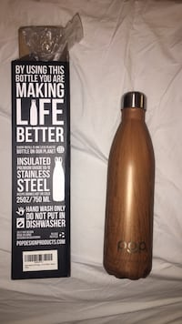 Unused stainless steel bottle with wooden design  London, W6
