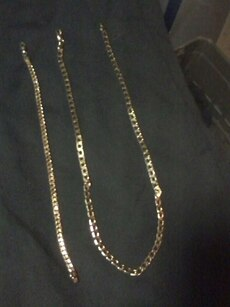Gold wrist chain and gold necklace