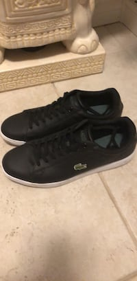 Pair of black leather Lacoste low-top shoes  Brampton, L6V 4H8