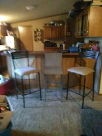 brown wooden table with chairs Lafayette