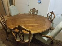 round brown wooden pedestal table with four chairs Tampa, 33605
