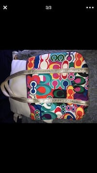 white, red, and blue Coach leather wristlet Phoenix, 85041