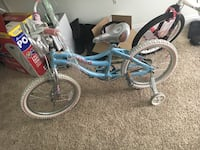 teal and white bicycle with pair of training wheels 61 km