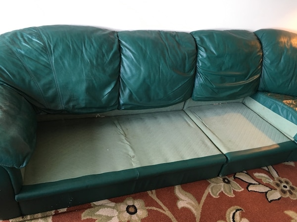 4-section Green couch. Willing to negotiate  f07963f2-d29f-45cb-8120-6eaaf3aca121