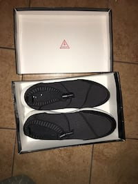 Pair of black Guess slide shoes