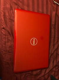Red dell laptop with ac adapter. Not used often. $375 or best offer