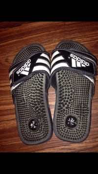 pair of black-and-white Adidas slide sandals 35 km